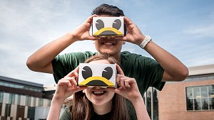two students wearing UO virtual reality goggles