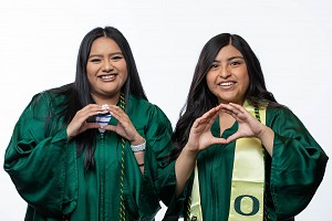 PathwayOregon students throwing the O in their caps and gowns
