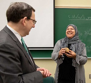 President Michael Schill presenting Hanan Elsherif with the Distinguished Teacher Award